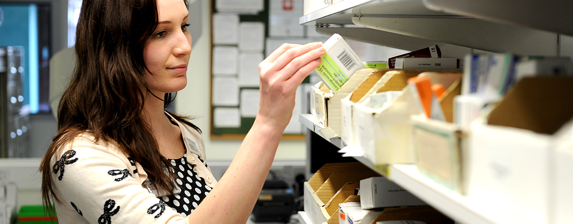 A member of our pharmacy team selecting medication