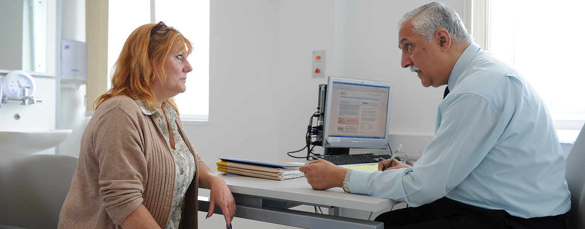 A Rheumatology consultant and patient in clinic