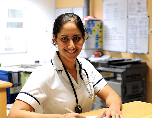 Clinical staff member at ward desk
